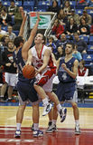 Basketball boys drive. Matt Daley of Bathurst drives to the hoop against Leo Hayes at the 2011 New Brunswick high school senior boys AAA basketball championship Royalty Free Stock Images
