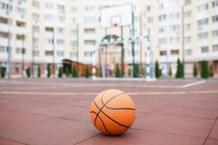 Basketball, a bright, new ball lies on the red, rubber coating of the stadium. Basketball, bright, new ball lies on the red, rubber coating of the open stadium Stock Photos