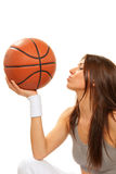 Basketball brunette woman player kissing ball Stock Photo