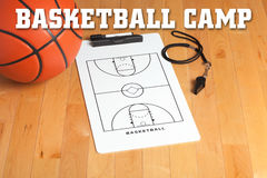 Basketball camp letters on background of wooden floor with clipb Stock Photography