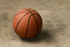 Basketball on cement floor stock photography