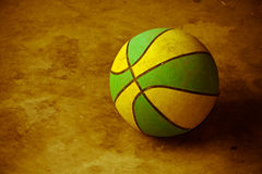 Basketball on cement floor Royalty Free Stock Photos