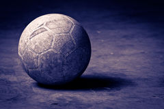 Basketball on cement floor. Vintage picture of a basketball on cement floor royalty free stock photo