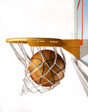 Basketball centering the basket, close up view. Royalty Free Stock Photos