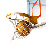 Basketball Centering The Basket, Close Up View. Stock Photo