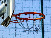 Basketball chain hoop and ring. With blue sky Royalty Free Stock Photo