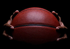 Basketball closeup and Hand Gripping Stock Photography