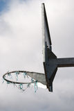 Basketball on a cloudy day. A close up of a basketball bar and old net on a cloudy day Royalty Free Stock Photos