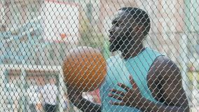 Basketball coach eagerly waiting for team at sports ground, outdoor training. Stock footage stock video
