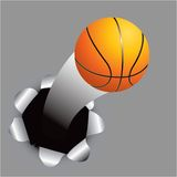 Basketball coming out of hole Royalty Free Stock Photography