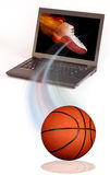 Basketball and computer Royalty Free Stock Image