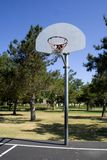 Basketball court. A empty basketball court on a bright summer day Stock Photos