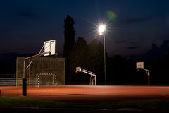 Basketball Court. Night Shot Of School Basketball Court with Nice Lens Flare Royalty Free Stock Photos