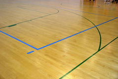 Basketball court. Wooden basketball court. Indoor sports playground Royalty Free Stock Photo