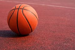 Basketball on a court Stock Images