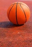Basketball on court. Basketball ball on court outdoor stock photo