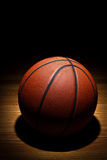 Basketball on court Royalty Free Stock Photo