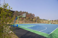 Basketball Court. Outdoor basketball court, with the mountain water Stock Photo