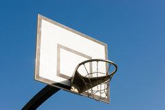 Basketball on a court. Basketball hoop against the blue sky Stock Photo