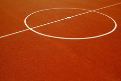 Basketball court. With a red rubber floor Royalty Free Stock Image