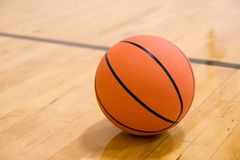 Basketball on Court. Single basketball sitting on court Royalty Free Stock Images
