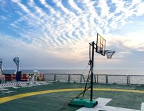 Basketball court backboard on helideck in seismic vessel ship in Andaman Sea. For oil and gas survey with cloudy sky background Stock Image