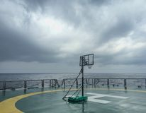 Basketball court backboard on helideck in seismic vessel ship in Andaman Sea. For oil and gas survey with cloudy sky background Royalty Free Stock Image