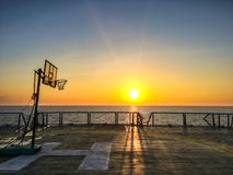 Basketball court backboard on helideck in seismic vessel ship. During sunset in Andaman Sea for oil and gas survey with sky background Stock Photo