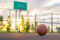 Basketball court. A basketball ball lies on the ground in the ba royalty free stock photos