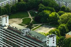 Basketball court buildings and trees Stock Photos