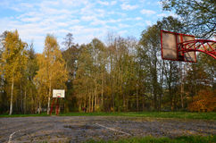 Basketball court in a city park autumn Stock Images