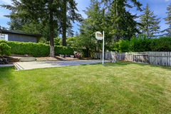 Basketball court with concrete floor and wooden fence Stock Image