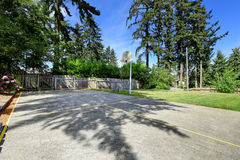 Basketball court with concrete floor and wooden fence Royalty Free Stock Photos