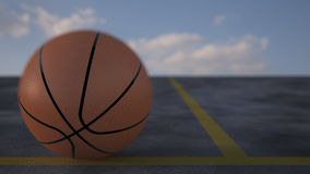 Basketball On A Court. 3D render of an basketball on a court Stock Photography