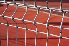 Basketball court fenced with a metal fence royalty free stock image