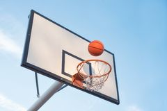 Basketball court goal with blue sky background.  stock images