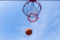 Basketball ball flight blue outdoors Royalty Free Stock Photos