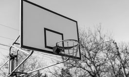 Basketball court and hoop. Basketball hoop in the yard, court at neighborhood royalty free stock photography