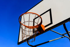 Basketball court and hoop. Basketball hoop in the yard, court at neighborhood Royalty Free Stock Photos