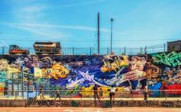 Marseilles-Friche La Belle De Mai-Basketball Court. Basketball court in`La Friche la Belle de Mai` a heavy graffiti cultural site including T.V and Cinema set in royalty free stock photo