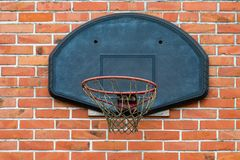 Basketball court outdoor in front of a old brick wall Royalty Free Stock Photo