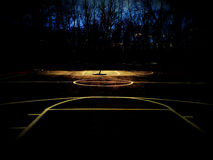 Basketball court outdoors in the twilight. Outdoor basketball court with unique lighting in the twilight hours Stock Photography