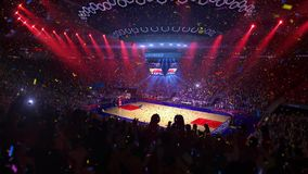 Basketball court with people fan. Sport arena. Ready to start championship. 3d render. Moving lights Confetti and tinsel. Basketball court with people fan. Sport stock footage