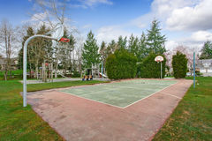 Basketball court and playground for kids Stock Image