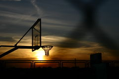 Basketball Court. A silhouette photo of a basketball court during a sunset Stock Photography