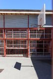 Basketball court surrounded by metal bars in city Stock Image