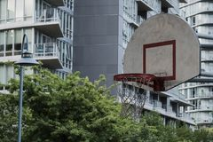 Basketball court in urban area. Dusk, dramatic view. Vancouver BC, Canada Stock Images