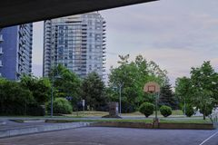 Basketball court in urban area. Dusk, dramatic view. Vancouver BC, Canada Stock Image