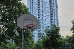 Basketball court in urban area. Dusk, dramatic view. Vancouver BC, Canada Stock Photos