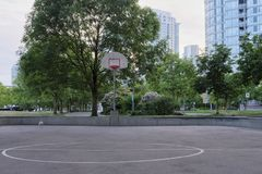 Basketball court in urban area. Dusk, dramatic view. Vancouver BC, Canada Royalty Free Stock Photography